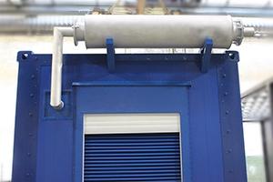 Фотография выхлопной трубы с катализатором