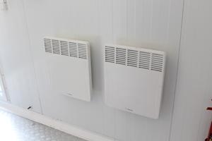 Фото панели отопления в контейнере для ДГУ